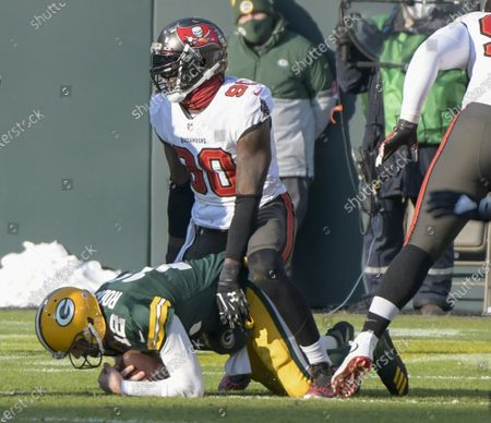 Stock Image of Tampa Bay Buccaneers outside linebacker Jason Pierre-Paul (90) sacks Green Bay Packers quarterback Aaron Rodgers (12) in the first half of the NFC Championship