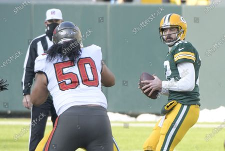 Stock Photo of Green Bay Packers quarterback Aaron Rodgers (12) looks for an open receiver against the Tampa Bay Buccaneers in the first half of the NFC Championship