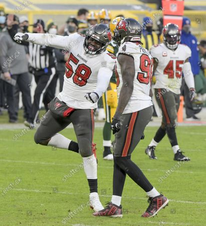 Stock Picture of Tampa Bay Buccaneers outside linebackers Shaquil Barrett (58) and Jason Pierre-Paul (90) celebrate the sack of Green Bay Packers quarterback Aaron Rodgers (12) in the second half of the NFC Championship