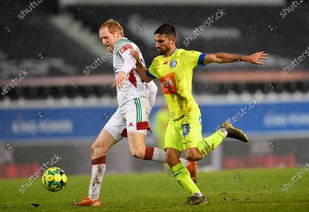 OHL's Vaclav Jemelka and Gent's Milad Mohammadi fight for the ball during a soccer match between OH Leuven and KAA Gent, Sunday 24 January 2021 in Heverlee, on day 21 of the 'Jupiler Pro League' first division of the Belgian championship.