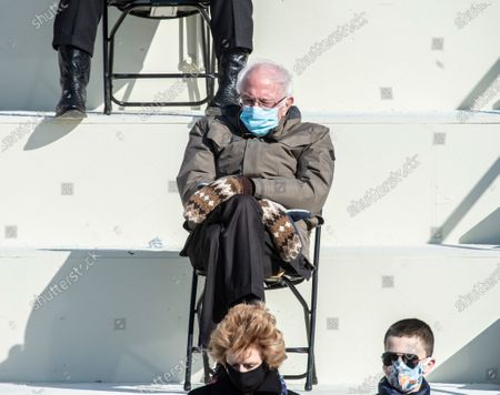 US Senator, Bernie Sanders with his gloves at the Inauguration of U.S. President Joe Biden and Vice President Kamala Harris before a small crowd on the West Front of the U.S. Capitol building