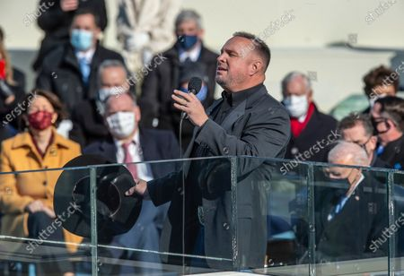 Stock Photo of Garth Brooks, preforms at the Inauguration of U.S. President Joe Biden and Vice President Kamala Harris before a small crowd on the West Front of the U.S. Capitol building