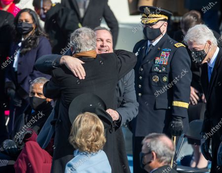 County Singer, Garth Brooks hangs former President George Bush at the Inauguration of U.S. President Joe Biden and Vice President Kamala Harris before a small crowd on the West Front of the U.S. Capitol building