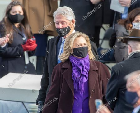 Stock Picture of President Bill Clinton and Hillary Clinton at the Inauguration of U.S. President Joe Biden and Vice President Kamala Harris before a small crowd on the West Front of the U.S. Capitol building