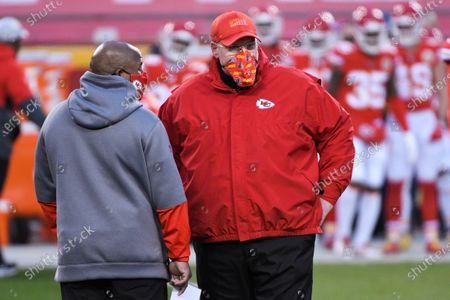 Kansas City Chiefs head coach Andy Reid and offensive coordinator Eric Bieniemy chat during pre-game activities before the NFL AFC championship football game between the Kansas City Chiefs and the Buffalo Bills, in Kansas City, Mo