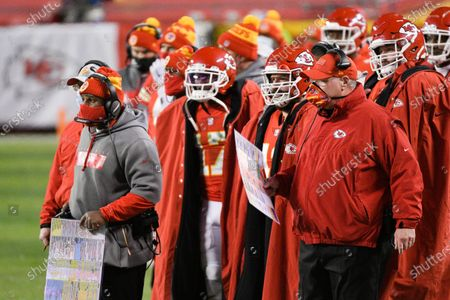 Kansas City Chiefs head coach Andy Reid (right) and offensive coordinator Eric Bieniemy (far left, with play sheet) watch from the sidelines during the first half of the NFL AFC championship football game against the Buffalo Bills, in Kansas City, Mo
