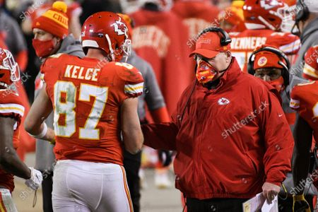 Kansas City Chiefs tight end Travis Kelce is congratulated by Kansas City Chiefs head coach Andy Reid after scoring a touchdown during the second half of the NFL AFC championship football game against the Buffalo Bills, in Kansas City, Mo