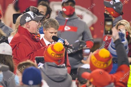 Kansas City Chiefs head coach Andy Reid gives an interview, with Chiefs owner Lamar Hunt to his left, after beating the Buffalo Bills in the NFL AFC championship football game, in Kansas City, Mo