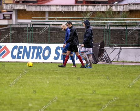 """Stock Picture of Referee Andrea Colombo today, after a couple of inspections on the heavy turf reduced to a paddy field due to the rain that continues to fall on the city of Campania, decided not to start the match at the Marcello Torre stadium. The last check at 15.25, carried out in the company of the captains Silvestri (Catania) and Sirignano (Paganese) The match at the """"Marcello Torre"""" stadium was not played today, valid for the 20th day of group C of Serie C pushed the referee to send everyone back to the locker room."""