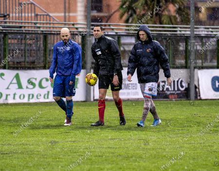 """Stock Photo of Referee Andrea Colombo today, after a couple of inspections on the heavy turf reduced to a paddy field due to the rain that continues to fall on the city of Campania, decided not to start the match at the Marcello Torre stadium. The last check at 15.25, carried out in the company of the captains Silvestri (Catania) and Sirignano (Paganese) The match at the """"Marcello Torre"""" stadium was not played today, valid for the 20th day of group C of Serie C pushed the referee to send everyone back to the locker room."""