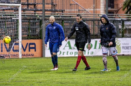 """Stock Image of Referee Andrea Colombo today, after a couple of inspections on the heavy turf reduced to a paddy field due to the rain that continues to fall on the city of Campania, decided not to start the match at the Marcello Torre stadium. The last check at 15.25, carried out in the company of the captains Silvestri (Catania) and Sirignano (Paganese) The match at the """"Marcello Torre"""" stadium was not played today, valid for the 20th day of group C of Serie C pushed the referee to send everyone back to the locker room."""