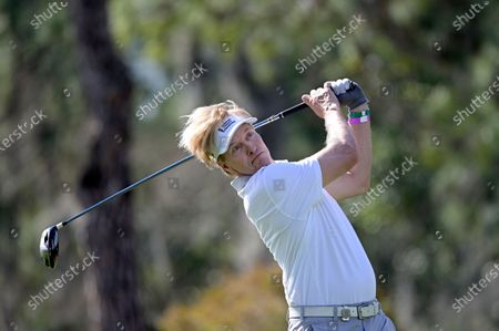 Actor Jack Wagner watches his tee shot on the 16th hole during the final round of the Tournament of Champions LPGA golf tournament, in Lake Buena Vista, Fla