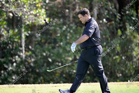 News television host Bret Baier walks on the eighth hole after hitting from the fairway during the final round of the Tournament of Champions LPGA golf tournament, in Lake Buena Vista, Fla