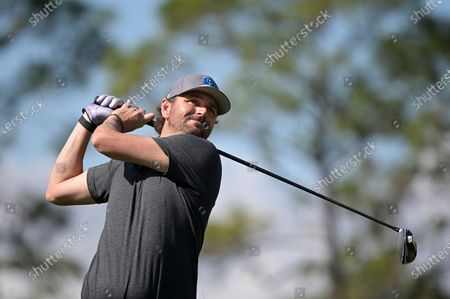 Former professional tennis player Mardy Fish watches his tee shot on the fourth hole during the final round of the Tournament of Champions LPGA golf tournament, in Lake Buena Vista, Fla