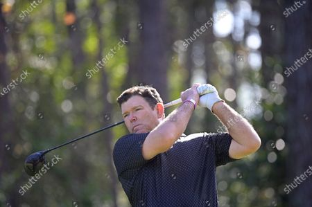 News television host Bret Baier watches his tee shot on the second hole during the final round of the Tournament of Champions LPGA golf tournament, in Lake Buena Vista, Fla