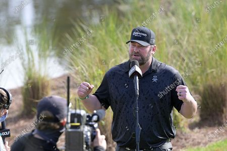 Country music singer Lee Brice is interviewed near the 18th tee during the final round of the Tournament of Champions LPGA golf tournament, in Lake Buena Vista, Fla