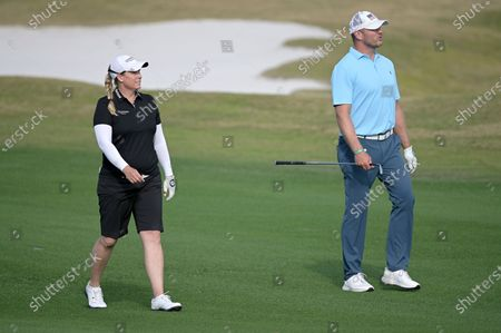 Stock Photo of Brittany Lincicome, left, and former NFL football player Brian Urlacher walk on the 17th fairway during the final round of the Tournament of Champions LPGA golf tournament, in Lake Buena Vista, Fla