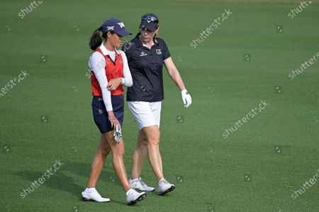 Celine Boutier, left, of France, and Annika Sorenstam, of Sweden, walk on the 17th fairway during the final round of the Tournament of Champions LPGA golf tournament, in Lake Buena Vista, Fla