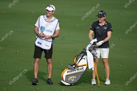Annika Sorenstam, right, of Sweden, and her caddie, husband Mike McGee share a laugh on the 17th fairway during the final round of the Tournament of Champions LPGA golf tournament, in Lake Buena Vista, Fla