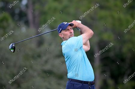 Former professional baseball player John Smoltz watches his tee shot on the 17th hole during the final round of the Tournament of Champions LPGA golf tournament, in Lake Buena Vista, Fla