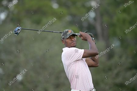 Stock Picture of Former NBA basketball player Ray Allen watches his tee shot on the 17th hole during the final round of the Tournament of Champions LPGA golf tournament, in Lake Buena Vista, Fla