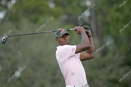 Former NBA basketball player Ray Allen watches his tee shot on the 17th hole during the final round of the Tournament of Champions LPGA golf tournament, in Lake Buena Vista, Fla