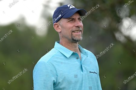 Former professional baseball player John Smoltz walks on the 17th hole after hitting his tee shot during the final round of the Tournament of Champions LPGA golf tournament, in Lake Buena Vista, Fla
