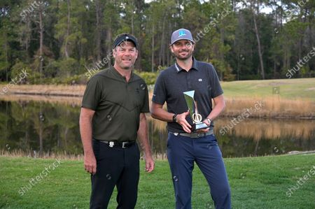 Mardy Fish, right, poses with Mike Flaskey, CEO of Diamond Resorts International, after Fish won the celebrity division of the Tournament of Champions LPGA golf tournament, in Lake Buena Vista, Fla