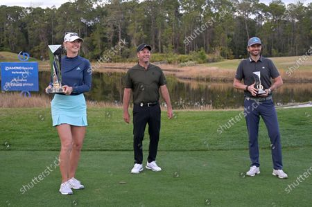 Jessica Korda holds the championship trophy on the 18th green after winning in a one-hole playoff against Danielle Kang during the final round of the Tournament of Champions LPGA golf tournament, in Lake Buena Vista, Fla. Standing with Korda is Mike Flaskey, CEO of Diamond Resorts International, and Mardy Fish, right, winner of the celebrity division