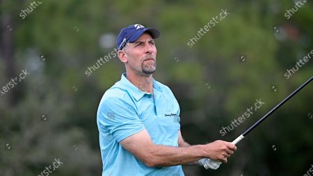 Stock Picture of Former professional baseball player John Smoltz watches his tee shot on the 17th hole during the final round of the Tournament of Champions LPGA golf tournament, in Lake Buena Vista, Fla