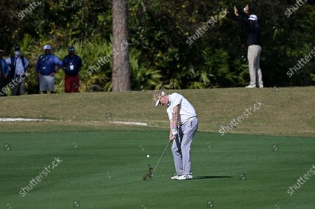 Actor Jack Wagner hits from the 15th fairway during the final round of the Tournament of Champions LPGA golf tournament, in Lake Buena Vista, Fla