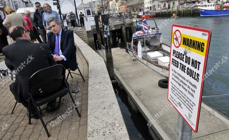 South Dorset MP and Employment Minister Jim Knight with  Gordon Brown having tea on Weymouth Quay