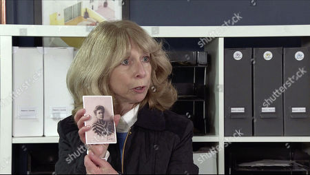 Coronation Street - Ep 10231 Monday 25th January 2021 - 1st Ep A loose photo flutters to the floor. Gail Rodwell, as played by Helen Worth, picks it up and is bemused to see a picture of a lady called Fanny.
