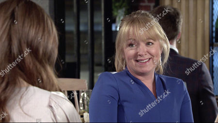 Stock Photo of Coronation Street - Ep 10240 Wednesday 3rd February 2021 - 2nd Ep At the bistro, Jenny Connor's, as played by Sally-Ann Matthews, flattered when a hot looking bloke checks her out. Devious Daisy Midgeley, as played by Charlotte Jordan, nips over and asks him for his phone number.