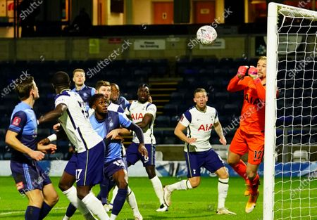 Goalkeeper Joe Hart of Tottenham Hotspur punches clear and prevents a Wycombe corner from going straight in early on
