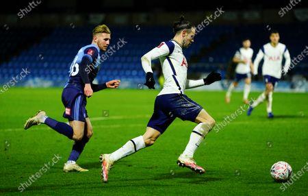 Jason McCarthy of Wycombe chases Gareth Bale of Tottenham Hotspur