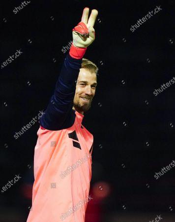 Goalkeeper Joe Hart of Tottenham Hotspur greets his opposing goalkeepers ahead of the warm up