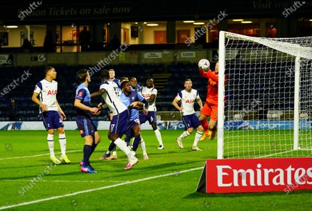 Goalkeeper Joe Hart of Tottenham saves and prevents the ball going straight in from a corner
