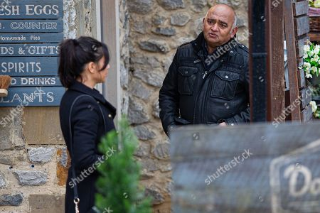 Emmerdale - Ep 8957 Monday 1st February 2021 Priya Sharma, as played by Fiona Wade, and Jai fuss around Rishi Sharma, as played by Bhasker Patel, worried about him.