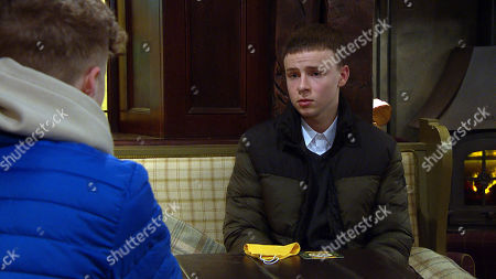 Emmerdale - Ep 8964 Tuesday 9th February 2021 Samson Dingle, as played by Sam Hall, is uneasy as Noah Tate, as played by Jack Downham, passes him an empty water bottle - he's asked him to give a urine sample so Noah can pretend it's his and pass the medical.