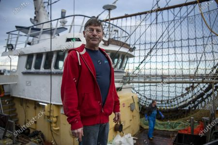 JUST WHEN WE THOUGHT THAT FOR THEM, THE BREXIT WAR WAS OVER... FOR four tempestuous days and nights the trawler Sam of Ladram had been scooping up cuttlefish, 20 miles off our South-West coast. By Thursday morning the storm had abated, and I watched its five crew offload the inky catch known as 'black gold' in these parts in their home port of Brixham, Devon.  Skipper John John (correct) from fishing boat â€oeSam of Ladram†unload a valuable catch of cuttlefish which sells to Italy and Spain. The ship is based in Brixham, Devon. After Brexit, Wholesaler Ian Perks†business has seen a steep reduction in orders and an increased paperwork load to sell to European buyers.