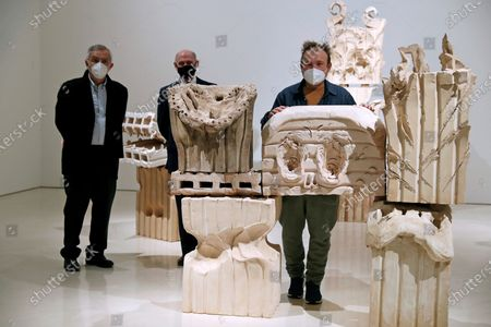 Spanish artist Miquel Barcelo (R) poses with his sculpture 'Totem' next to Picasso Museum's Director, Jose Lebrero (L), and Pablo Picasso's grandson Bernard Ruiz-Picasso during the presentation of the exhibition 'Miquel Barcelo. Metamorphosis' at Picasso Museum, in Malaga, southern Spain, 25 January 2021. The exhibition features some 100 art pieces by Barcelo.