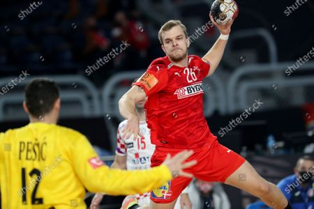 Denmark's Johan P. Hansen (R) in action against Croatia goalkeeper Ivan Pesic (L) during the Main Round match between Denmark and Croatia at the 27th Men's Handball World Championship in Cairo, Egypt, 25 January 2021.