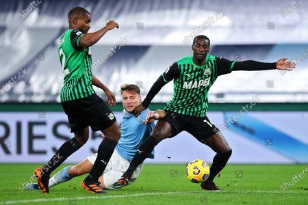 Marlon and Pedro Obiang (Sassuolo) Ciro Immobile (Lazio) during the match