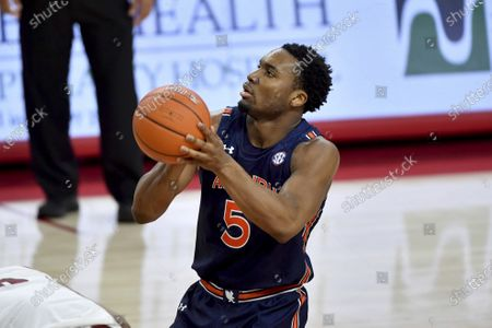 Stock Photo of Auburn forward Chris Moore shoots a free throw against Arkansas during an NCAA college basketball game, in Fayetteville, Ark