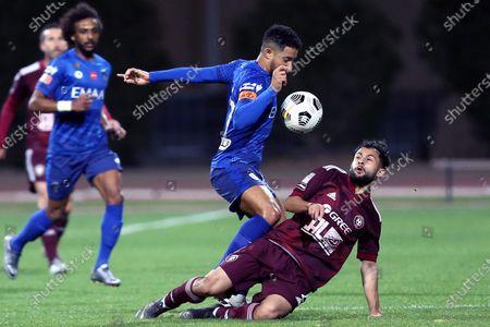 Al-Faisaly's player Abdullah Al-Hassan (R) in action against Al-Hilal's Hattan Bahebri (L) during the Saudi Professional League soccer match between Al-Faisaly and Al-Hilal at Al- Majma'ah Sports Stadium, Al Majma'ah, Saudi Arabia, 25 January 2021.