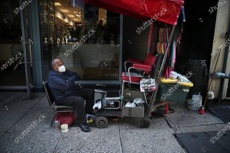Shoe shiner Jose Garcia waits for clients during the COVID-19 pandemic on Paseo de la Reforma in Mexico City