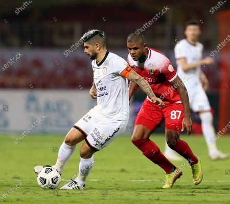 Al-Wehda's player Anselmo (R) in action against Al-Shabab's Ever Banega (L) during the Saudi Professional League soccer match between Al-Wehda and Al-Shabab at King Abdulaziz Stadium, Mecca, Saudi Arabia, 25 January 2021.