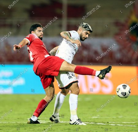 Al-Wehda's player Alaa Al Hejji (L) in action against Al-Shabab's Ever Banega (R) during the Saudi Professional League soccer match between Al-Wehda and Al-Shabab at King Abdulaziz Stadium, Mecca, Saudi Arabia, 25 January 2021.