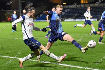 Wycombe Wanderers defender Jason McCarthy (26) blocks a cross from Tottenham Hotspur forward (on loan from Real Madrid) Gareth Bale (9) during the FA Cup match between Wycombe Wanderers and Tottenham Hotspur at Adams Park, High Wycombe